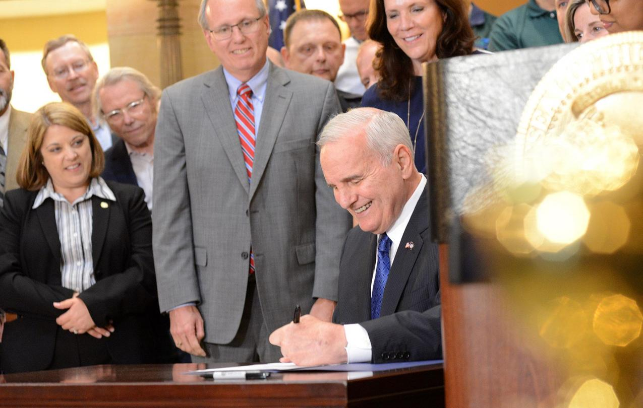 Governor Dayton makes history by signing the 2018 Omnibus Pension Bill into law